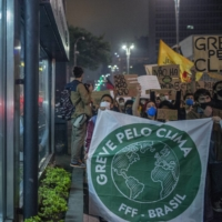 Demonstrators gather during the Global Climate Strike protest in Sao Paulo on Friday.  | BLOOMBERG
