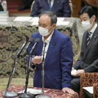 Prime Minister Yoshihide Suga speaks at a House of Representative committee meeting on Tuesday. | KYODO