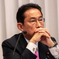 Former Foreign Minister Fumio Kishida listens during a debate ahead of the Liberal Democratic Party's presidential election, at its headquarters in Tokyo on Sept. 20. | POOL / VIA AFP-JIJI