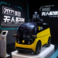 An autonomous delivery vehicle by Meituan is displayed at the World Artificial Intelligence Conference (WAIC) in Shanghai.   REUTERS