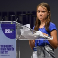 Swedish climate activist Greta Thunberg delivers a speech during the opening plenary session of the Youth4Climate event, on Tuesday in Milan.  | AFP-JIJI