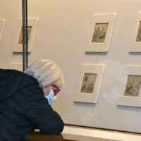 A visitor looks at sketches of Katsushika Hokusai at an advance viewing of an exhibit at the British Museum in London on Tuesday. | KYODO