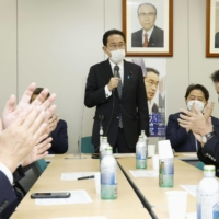 Former Foreign Minister Fumio Kishida speaks at a meeting of his faction in Tokyo on Tuesday. | KYODO
