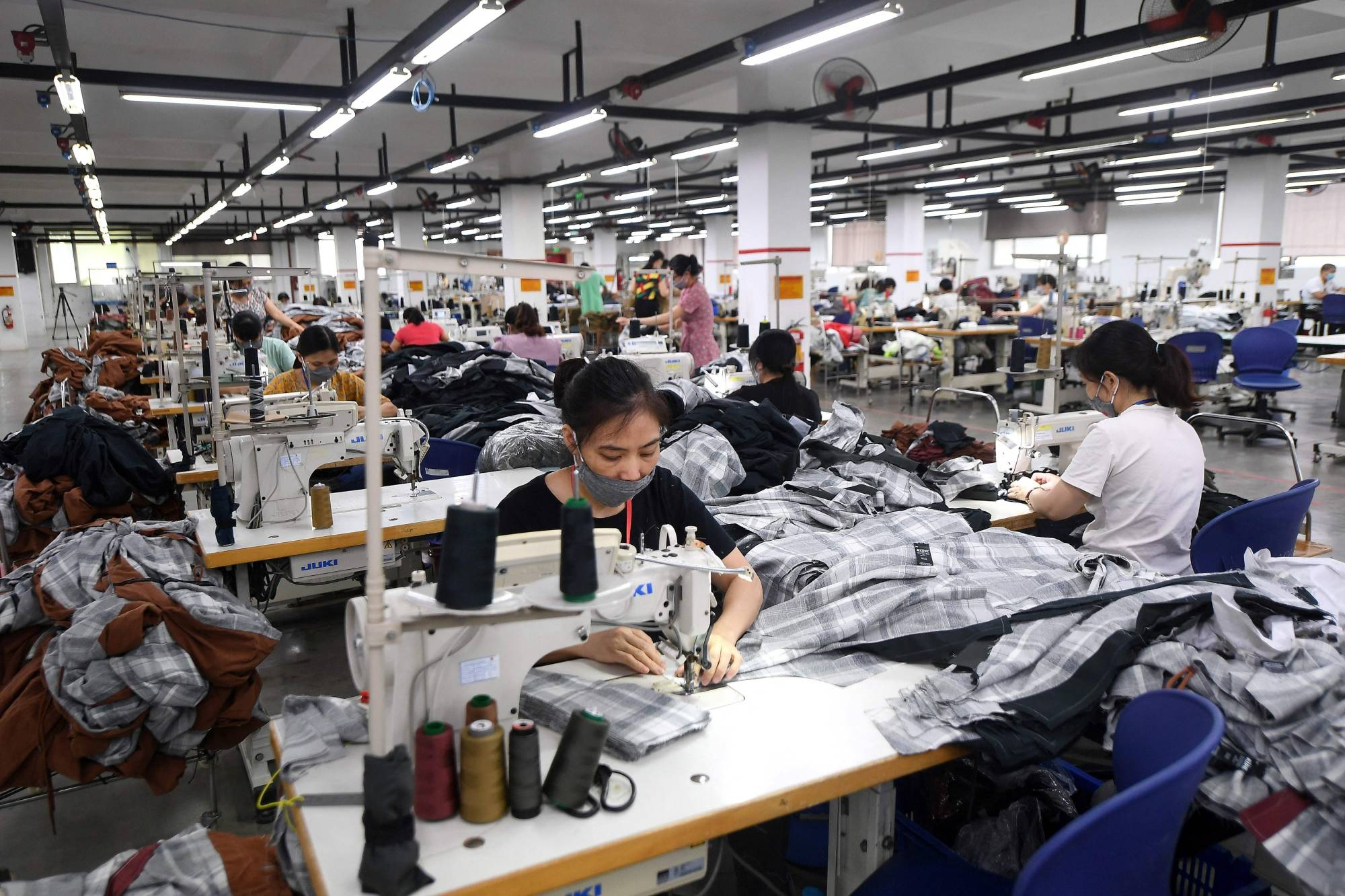 A factory belonging to Maxport Vietnam, which makes activewear for various textile clothing brands, in Hanoi   AFP-JIJI
