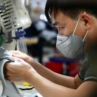 Even with the prospect of lockdowns easing, many are fretting over the long-term impact on Vietnamese manufacturing, with Nike and Adidas admitting they were looking to temporarily produce elsewhere.   AFP-JIJI