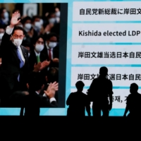 A screen shows the news of Fumio Kishida winning the ruling party's leadership election in Tokyo on Wednesday.   REUTERS