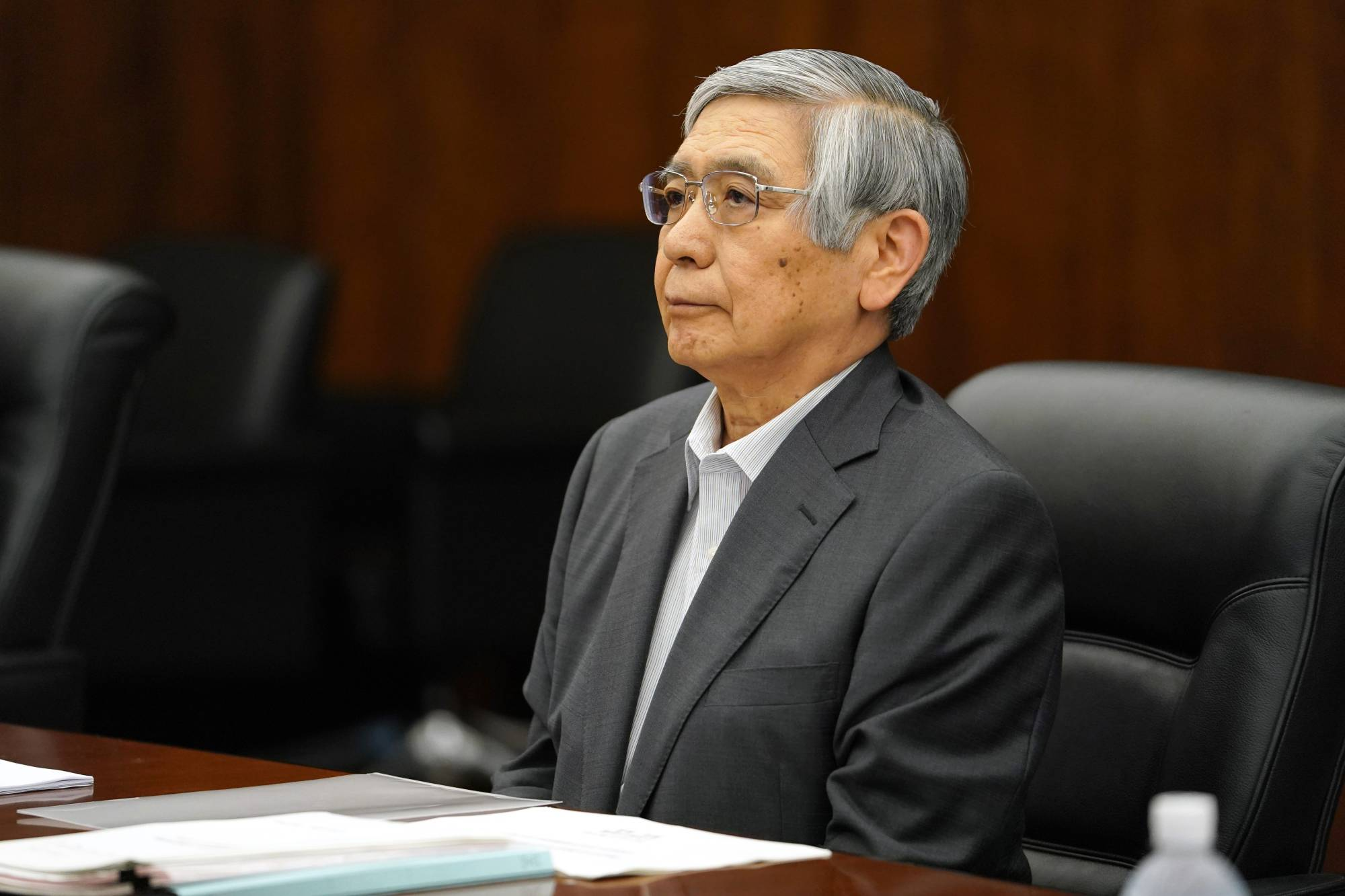 BOJ Gov. Haruhiko Kuroda played down the risk of a financial crisis from China's troubled real estate market.   BLOOMBERG