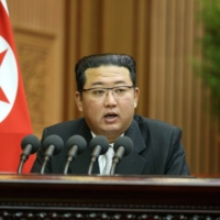 North Korean leader Kim Jong Un delivers a policy speech in an undated photo released Thursday. | KCNA / VIA REUTERS