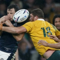 Australia's Greg Holmes tackles Scotland's John Hardie during their match at the Rugby World Cup in London in 2015. | REUTERS