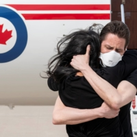 Former diplomat Michael Kovrig embraces his wife, Vina Nadjibulla, after arriving in Toronto on Saturday following nearly three years in detention in China.  | CANADIAN DEFENSE DEPARTMENT / VIA REUTERS