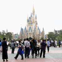 Tokyo Disney parks will raise its daily visitor cap to 10,000 from Friday.   KYODO
