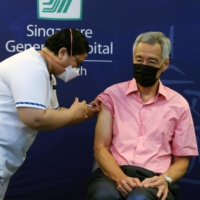 Singapore's Prime Minister Lee Hsien Loong receives a COVID-19 booster shot at the Singapore General Hospital on September 17, 2021.  | REUTERS
