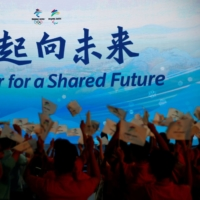 The Beijing 2022 Winter Olympics slogan, 'Together for a shared future,' is unveiled in Beijing. China has asked Japan for support on holding the Games during the COVID-19 crisis.  | REUTERS