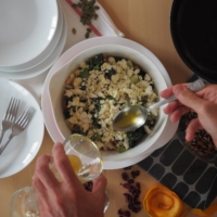 Mix with the persimmon, radicchio, feta and remaining olive oil to combine.   SIMON DALY