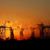 Electricity pylons in front of the cooling towers at the coal-burning Lethabo Thermal Power Station near Sasolburg, South Africa, in March 2016 | REUTERS