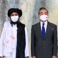 Mullah Abdul Ghani Baradar, political chief of the Taliban, meets with Chinese State Councilor and Foreign Minister Wang Yi in Tianjin, China, on July 28. | XINHUA / VIA REUTERS