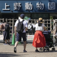 People wait in front of Ueno Zoological Gardens in Tokyo on Saturday on the first weekend after the lifting of the COVID-19 state of emergency amid dwindling infections. | KYODO