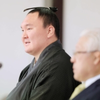 Former yokozuna Hakuho was required to sign a document pledging to observe the Japan Sumo Association's rules in order to become a sumo elder. | POOL / VIA REUTERS