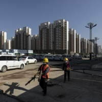 China steps up efforts to ring-fence Evergrande, not save it