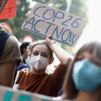 People rally on Saturday in Milan, Italy, while environment ministers meet ahead of Glasgow's COP26 meeting.  | REUTERS