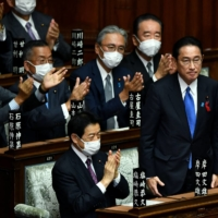 Liberal Democratic Party President Fumio Kishida is applauded after being elected prime minister in the Lower House in Tokyo on Monday.   AFP-JIJI