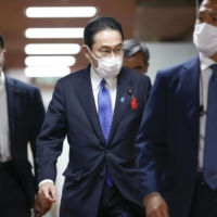 Liberal Democratic Party leader Fumio Kishida leaves the party's headquarters in Tokyo on Monday. | KYODO