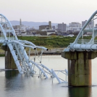 A section of a water pipe bridge is seen collapsed in the city of Wakayama on Sunday. | KYODO