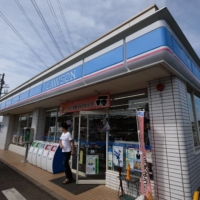 According to a July report from the Japan Franchise Association, the total number of convenience stores in Japan currently stands at 55,931, an increase of more than 10,000 outlets from a decade ago. | BLOOMBERG