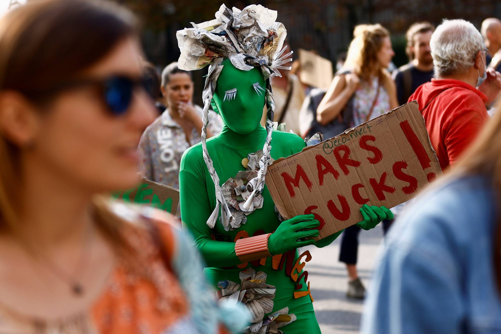 A costumed protester at a climate march in Milan   REUTERS