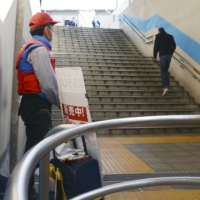 A man struggles to sell The Big Issue magazine in Osaka amid the pandemic as the number of passers-by has declined.  The magazine offers homeless people the opportunity to earn legitimate income.  |  KYODO