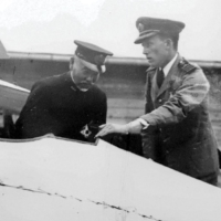 William Sempill shows a Gloster Sparrowhawk airplane to Adm. Togo Heihachiro in 1921.
