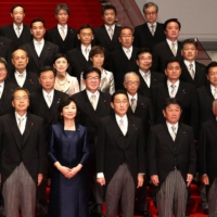 Prime Minister Fumio Kishida poses with members of his Cabinet at the Prime Minister's Office on Monday. | POOL / VIA AFP-JIJI