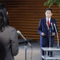Prime Minister Fumio Kishida speaks to reporters at the Prime Minister's Office in Tokyo on Tuesday. For Japan's new leader, boosting economic security is one of the top items on his agenda. | KYODO