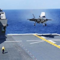 A U.S. Marine Corps F-35B stealth fighter jet lands on the Maritime Self-Defense Force's Izumo helicopter carrier in the waters off Shikoku on Sunday.   DEFENSE MINISTRY / VIA KYODO