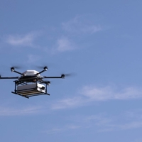 SoftBank Corp.'s drone flies from the fishing port of Susami to a roadside station.  | COURTESY OF SOFTBANK CORP.