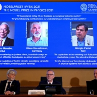 The winners of the Nobel Prize in physics are displayed during a news conference in Stockholm on Tuesday.    AFP-JIJI