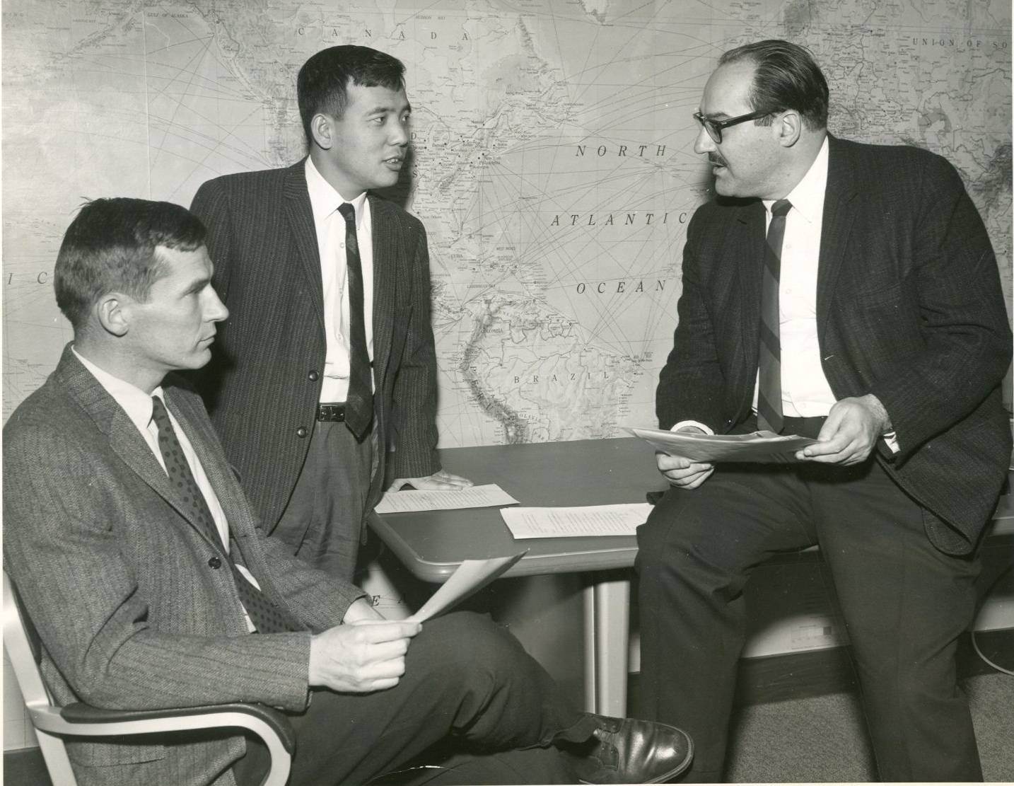 Syukuro Manabe (center) speaks with colleagues at Princeton University in 1969. | COURTESY OF THE GEOPHYSICAL FLUID DYNAMICS LABORATORY