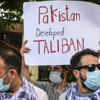Afghan nationals protest against Pakistan's alleged support to the Taliban in New Delhi on Sept. 14. | AFP-JIJI