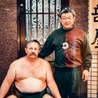 John Jacques poses with Miyagino stablemaster (the former Chikubayama) in the early 1990s. | COURTESY OF JOHN JACQUES