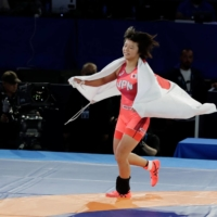 Tsugumi Sakurai celbrates after winning the 55 kg final of the 2021 World Freestyle Wrestling Championships in Oslo on Tuesday. | AFP-JIJI