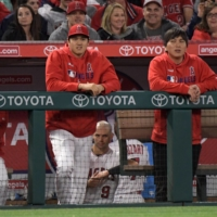 Interpreter Ippei Mizuhara (right) is among a number of supporting staffers who helped Shohei Ohtani accomplish his historic 2021 season.   USA TODAY / VIA REUTERS