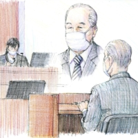 A court illustration shows Yoshiki Akita listening to a ruling handed down in Tokyo District Court Wednesday.   KYODO