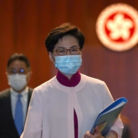 Hong Kong Chief Executive Carrie Lam departs after delivering her final annual policy address at the Legislative Council on Wednesday. | REUTERS