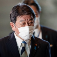Foreign Minister Toshimitsu Motegi arrives at the Prime Minister's Office in Tokyo on Monday. | REUTERS
