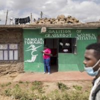 Atieno, a reproductive health worker, stands outside the offices of the Coalition of Grassroot Women Initative, which provides support to victims of sexual violence in Nairobi's Dandora slum.  | AFP-JIJI