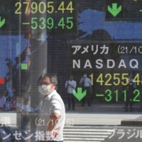 Stock information is displayed in Tokyo on Tuesday  | REUTERS