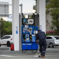 Higher gas prices are expected to place burdens on households as people travel after the government fully lifted its COVID-19 state of emergency on Friday. | BLOOMBERG