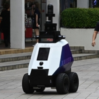 An autonomous robot named Xavier patrols a shopping and residential district in Singapore on Wednesday.    AFP-JIJI