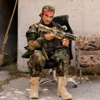 A Taliban soldier sits outside a news conference in Kabul on Oct. 5. | REUTERS