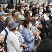 Voters gather in front of Shizuoka Station Thursday to listen to speeches as campaigning for Upper House by-elections kicked off.   KYODO